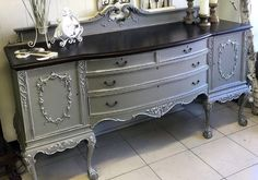 Jenny of Rustic Roots made over this buffet with General Finishes Empire Gray Chalk Style Paint. The details were accented with Snow White Milk Paint then topped with Champagne Pearl Effects followed by Bronze Pearl Effects. The top was stained with Java Gel Stain and sealed with High Performance Top Coat in satin and Flat out Flat Top Coat on everything else.