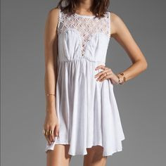 White Free People Dress Crochet and jacquard white free people dress, has beautiful vey subtle texture/print to the fabric, shown in last pic. This dress is very flowy and breezy, GREAT condition. Free People Dresses