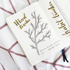 Bullet journal monthly mood tracker,  tree drawing. | @thizidizi