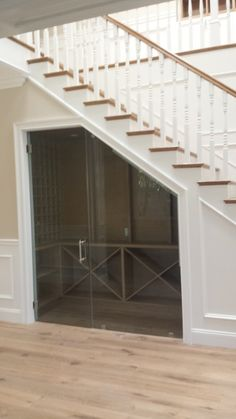 Wine Cooler Under the Stairs - Lightning Construction & Design - Tarzana, CA, United States. Wine cooler under the stairs