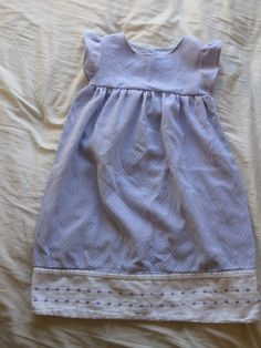I found an amazing tutorial for pillowcase nightgowns on here. Then, I saw this adorable purple and white polkadot pillowcase at Goodwill, and this little gem was created! If only I knew someone with a little girl who would wear it.