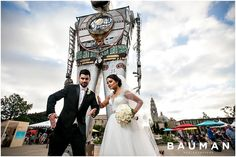 These two are truly up for anything. Do the Robot! At the Maker Faire in San Diego.   Balboa Park Wedding, Photography by Bauman Photographers  View More: http://baumanphotographers.com/blog/weddings/2015/10/gabe-emylou-the-prado-wedding/