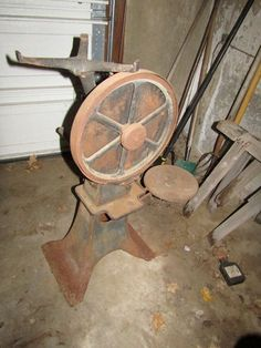 Antique De Laval cream separator No. 15 (functionality unk.); large vintage Parker bench vise No. 40; antique work bench; misc. vintage and antique items pictured on bench. Bring tools to disconnect vise from bench. These items are being sold buyer choice. Winning bidder may take what they want and leave the balance. Heavy items. Removal is via walkout basement. Bring assistance.