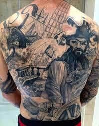 What does pirate tattoo mean? We have pirate tattoo ideas, designs, symbolism and we explain the meaning behind the tattoo. Pirate Ship Tattoo Black And Grey, Black And Grey Tattoos, Creative Tattoos, Cool Tattoos, Pirate Themed Tattoos, Crane, Full Tattoo, Tattoo Ink, Arm Tattoo