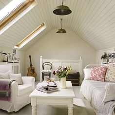 white furniture, twin bed as sofa, ikea chair, white ceiling and walls and floors, sky lights, small space