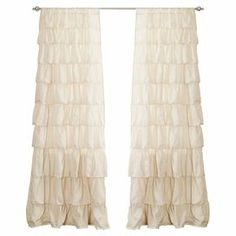 """Handcrafted ruffled curtain in ivory.   Product: CurtainConstruction Material: 100% PolyesterColor: IvoryFeatures: Handmade ruffle detailsDimensions: 84"""" H x 50"""" W Note: Image depicts two panels, but price is for one Cleaning and Care: Machine washable"""