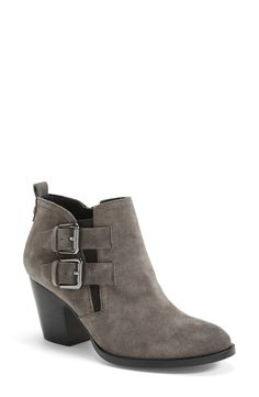 A duo of buckled straps and cool grey suede make this the perfect moto style bootie for fall.