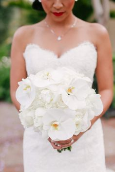Round white orchid bouquet: http://www.stylemepretty.com/2015/11/22/sofia-vergaras-orchid-wedding-bouquet/