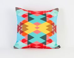 Brighten your room with this geometric pillow.