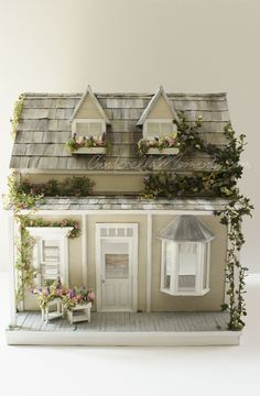 Adorable cottage with climbing vines and bay window