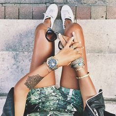 It's still #summer. French fashion blogger @noholita wearing her Nixon Bullet Chrono with style. #Gold Watch