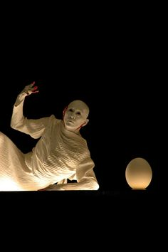 Sankai Juku - Japanese Butoh company: work Unetsu – The Egg stands out of Curiosity. first performed in 1986.  photo by Alan Eglinton, a Paris-based freelance photographer.
