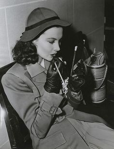 Vivien Leigh touching up her lips on the set of Waterloo Bridge, 1940.