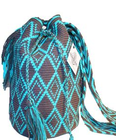 Each of these bags is hand-woven by the tribe's woman artisans using age old…