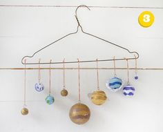 Solar system craft using a clothes hanger, http://hative.com/solar-system-project-ideas-for-kids/