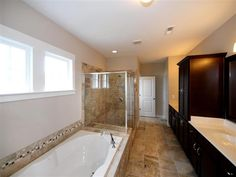 Luxurious Owner's Bath features a Linen Tower, Dual Sinks, Tile Shower, Dual Closets and Garden Tub.  The Dawson at McCullough, Homesite 75.