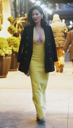 All dressed up: The stunning actress shone in a low-cut yellow dress, which accentuated her famous curves