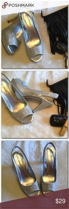 Gorgeous Sparkle Heels Stunning sparkle heels, perfect to dress up any outfit. Only worn to try on. Bought for my daughters homecoming and she found another pair. Excellent condition. New in box. Shoes Heels