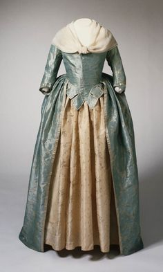 Woman's Dress (Open Robe)  Artist/maker unknown, American or English. Fabric Woven in Spitalfields, London, England.  Geography: Made in England, Europe or United States, North and Central America Date: c. 1785-1795 Medium: Light blue taffeta with ivory weft floats, ivory silk satin, ivory silk plain weave ribbon Accession Number 1955-78-2