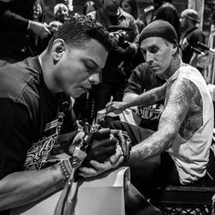Chuey Quintanar laying down some ink on Travis Barker while at the Agenda Trade Show in  Las Vegas.  #tattoos #vegas #travisbarker #westcoast