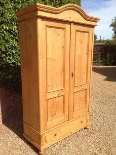 Pretty Victorian Pine Wardrobe with delicate bun feet. It has a drawer, internal shelf and rail