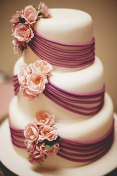 not crazy about the flowers but love the fondant ribbons-looking designs