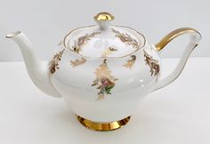 Circa Beautiful Thistle teapot made in England in the by Queen Anne. The teapot measures 10 Tea Rose Garden, Roses Garden, Tea Pot Set, Tea Sets, English Teapots, China Teapot, Bone China Tea Cups, Chocolate Pots, Tea Cup Saucer