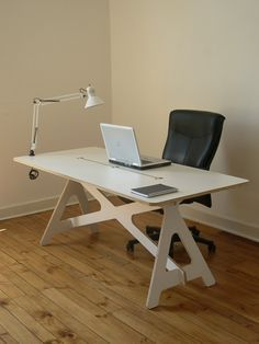 Desk that breaks down, stores flat, and requires no hardware to put together. Sweet!