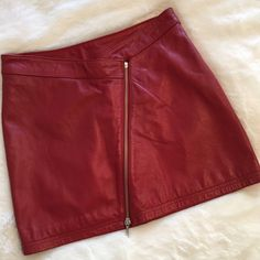 """❗️SALE❗️Wilson's Red Leather Mini Asymmetrical Zip Gorgeous and sexy! Wilson's Leather red genuine leather mini skirt with asymmetrical front zip. Brand new without tags. Fully lined. Just perfect! Size 6. Waist 14.25"""", length 15"""". ❌ NO TRADES ❌ NO LOWBALLING ❌ Wilsons Leather Skirts Mini"""