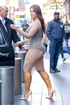 Spot the difference: The 28-year-old flaunted her curves in the revealing skintight number...