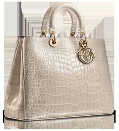 Dior.   Nice and big, but I'd like it with fake leather so I don't kill an alligator for my  bag :( also.. although I love Dior a lot, and many designers; I do not like carrying their logos on me I will remove the Dior part.