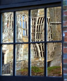Cowdray House Reflected in Window.