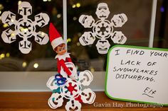 Elf on a Shelf - Antic: Snowflakes the windows overnight to help make it feel like the North Pole