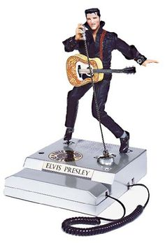Elvis Comeback Special Novelty Phone - The King of Rock  Roll lives on with this incredibly detailed scale replica telephone. This Elvis Phone features Elvis wearing his two piece black leather outfit to commemorate his 1968 comeback television