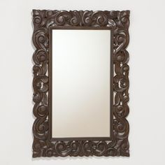 The rich, dark color of our Tegan Carved Mirror, handcrafted by skilled artisans in India of wood, creates a deep profile that expresses the antique elegance of fine art. The eye is drawn to tracing the beautiful hand-carved curves and flourishes of the frame.