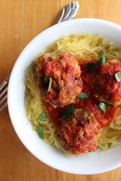 Paleo Meatballs & Spaghetti Squash - spaghetti squash, olive oil, yellow onion, garlic cloves, red pepper flakes, dried oregano, ground beef, mild Italian sausage, egg, almond meal, sea salt, low-sugar marinara sauce, fresh parsley (garnish)