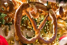 Pretzel with golden bows on fir twigs and pretzels background