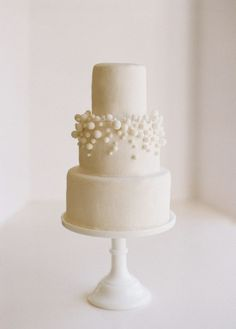 Beautiful and simple all-white fondant wedding cake