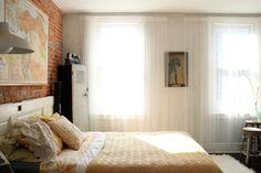 Light vintage bedroom exposed brick
