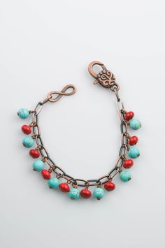 Red and turquoise blue howlite beads are wire wrapped to the links in the copper chain of this charming charm bracelet. The colors give this bracelet a southwestern flair, and it will also look great