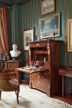 TRADITIONAL BEDROOM BY BROCKSCHMIDT & COLEMAN An Empire secrétaire abattant and a bust of Napoléon stand in a Manhattan guest room designed by Brockschmidt & Coleman; the walls are covered with a Claremont stripe.