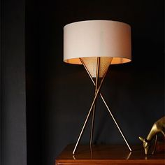 I like this lamp from West Elm. If not in my living room, then maybe I would purchase for guest room.