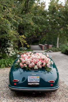 """From the editorial """"Look Up! This Wedding Ceremony Had 80 Individual Roses Suspended Overhead."""" @marksgarden was sure to incorporate unique floral moments in every aspect of the day! 