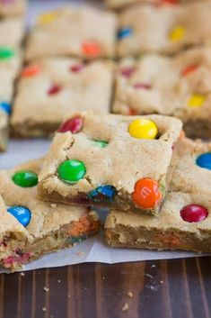 Thick and chewy M&M Cookie Bars stacked in a pyramid.