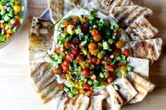 hummus heaped with tomatoes and cucumbers | smittenkitchen.com