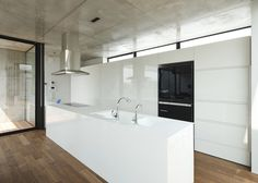 House for a surgeon in Chiba, Japan, by Apollo Architects & Associates with three courtyards behind its concrete walls.