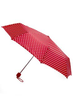 Beach Bumbershoot Umbrella in Red. When a gentle shower rolls over your beachfront getaway, you dont fret - instead, you slip on your sandals, throw your wrap around your shoulders, and pop open this pretty, polka-dotted umbrella! #gold #prom #modcloth