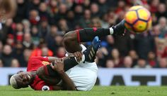 Paul Pogba of Manchester United lies injured during the Premier League match between Manchester United and AFC Bournemouth at Old Trafford on March 4...