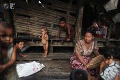 Myanmar Rohingya people pass the time at their slum near the sea in town of Sittwe.    Photo: Damir Sagolj / Reuters