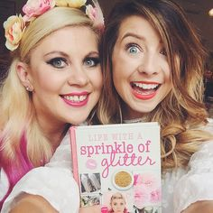 Zoella and Louise with Louise's new book 'Life with a sprinkle of glitter'. Cant wait to read it <3<3<3